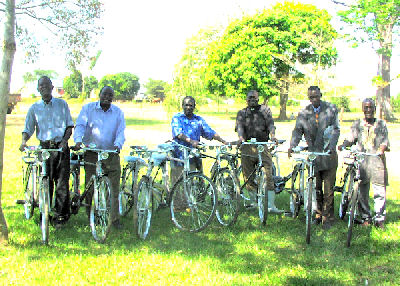 clergy on new bicycles